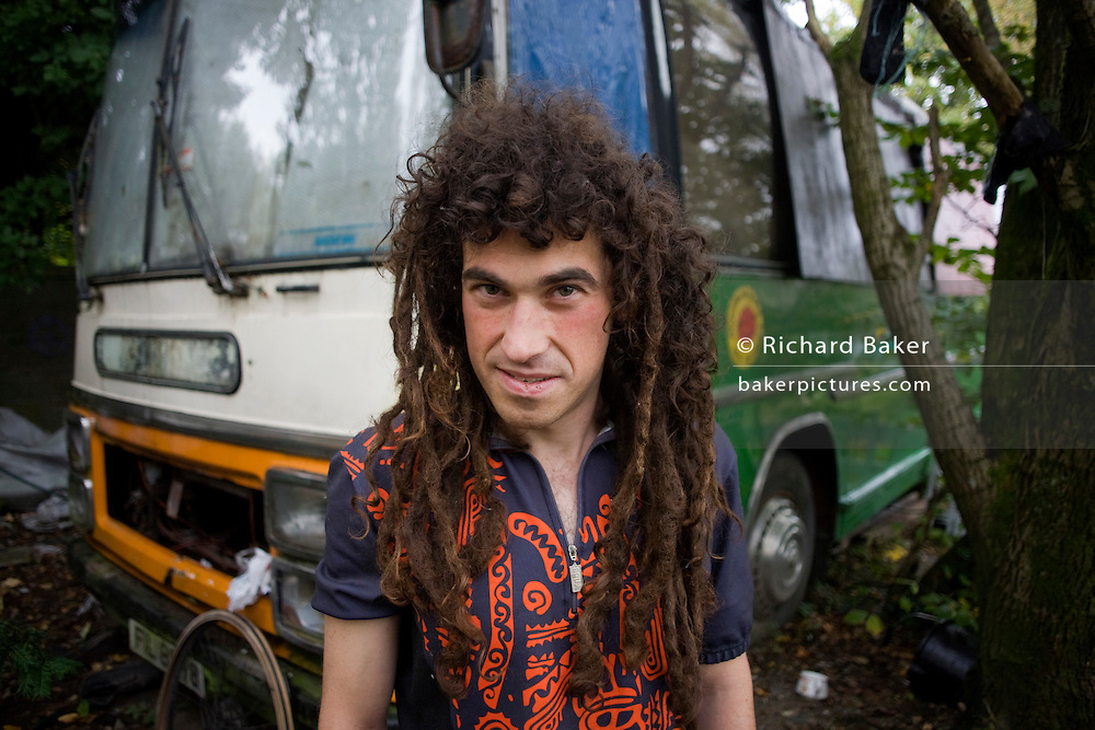 Activist 'Hoosie' aka Robert House, stands outside his bus-turned-home early on a Sunday morning at the Faslane Peace Camp...