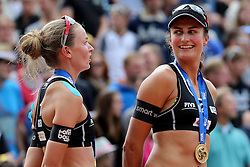 13.07.2014, Beach Village, Gstaad, SUI, FIVB Beach Volleyball Grand Slam Gstaad, im Bild Katrin Holtwick und Ilka Semmler (GER) // during the FIVB Beach Volleyball Grand Slam Gstaad at the Beach Village in Gstaad, Switzerland on 2014/07/13. EXPA Pictures © 2014, PhotoCredit: EXPA/ Freshfocus/ Claude Diderich<br /> <br /> *****ATTENTION - for AUT, SLO, CRO, SRB, BIH, MAZ only*****