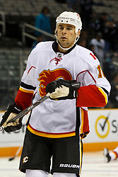 March 23, 2011; San Jose, CA, USA;  Calgary Flames right wing Tom Kostopoulos (16) warms up before the game against the San Jose Sharks at HP Pavilion. San Jose defeated Calgary 6-3. Mandatory Credit: Jason O. Watson / US PRESSWIRE