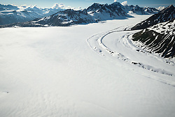 The upper regions of the Tsirku and Buckwell Glaciers start in Tatshenshini-Alsek Provincial Park. The Tsirku Glacier (foreground) flows downward to become the Tsirku River, near Haines, Alaska and the Buckwell Glacier (upper right) flows to become Michael Creek which shortly connects with the O&rsquo;Connor River. Tatshenshini-Alsek Provincial Park is located in the very northwestern corner of British Columbia, Canada. The park sits between Kluane National Park and Reserve in the Yukon and Glacier Bay and Wrangell-St. Elias National Parks and Preserves in Alaska. All together, they form the largest protected area in thew world, approximately 21 million acres. The Tatshenshini and Alsek Rivers are protected in their entirety making them the only large watershed in North America that is totally protected.<br /> <br /> The remote park is known for its spectacular glacier and icefields, rafting and kayaking, hiking and mountaineering. Tatshenshini-Alsek Provincial Park is home to grizzly bears, Dall's sheep, wolves, mountain goats, moose, eagles, falcons, and trumpeter swans.<br /> <br /> The park was designated a UNESCO World Heritage site in 1994.