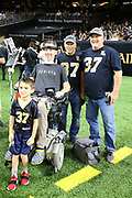 Nov 4, 2018; New Orleans, LA, USA: Former New Orleans Saints safety Steve Gleason takes a photo before a football game between the Los Angeles Rams and the Saints at the Mercedes-Benz Superdome. Gleason was diagnosed with Amyotrophic Lateral Sclerosis (ALS), considered a terminal neuro-muscular disease. The Saints beat the Rams 45-35. (Steve Jacobson/Image of Sport)