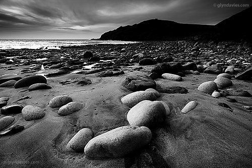 3 Edition A1 - 5 Edition A2<br /> <br /> In this cove of high erosion from weather and huge Atlantic waves, arose order. Boulders rounded like giant eggs seemed so beautifully placed in the gritty dark sand, left perfectly even by the receding ocean