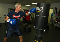 """James St Pierre throws out a series of punches during the Downtown Gym's """"Rock Steady Boxing"""" class Thursday evening.  (Karen Bobotas/for the Laconia Daily Sun)"""