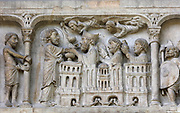 St Denis, Rustique and Eleuthera take communion, relief of the right side of the lintel on the portal on the North transept, depicting the beheading of St Denis, 12th century, at the Basilique Saint-Denis, Paris, France. The basilica is a large medieval 12th century Gothic abbey church and burial site of French kings from 10th - 18th centuries. Picture by Manuel Cohen