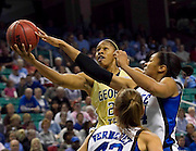 Georgia Tech (22) senior Alex Montgomery has her shot blocked by Duke senior Krystal Thomas (34) during Duke's 74 - 66 victory in the 2011 ACC Women's Basketball Tournament held at the Greensboro Coliseum in Greensboro, North Carolina.  (Photo by Mark W. Sutton)
