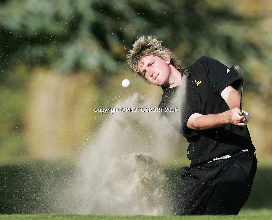 Australia's Mitchell Brown plays out a bunker during the final of the 2006 New Zealand Mens Golf Amateur Championship at Coringa Golf Course, Christchurch, on Sunday 9 April 2006. Brown played Shandon's Andrew Green who won the match and the championship. Photo: Tim Hales/PHOTOSPORT