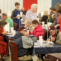 A crowd fills the dining area at Cravin' Catfish for Thanksgiving lunch on Thursday in Sherman.