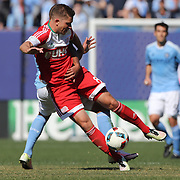 Chris Tierney, New England Revolution, is tackled by Tony Taylor, NYCFC, during the New York City FC Vs New England Revolution, MSL regular season football match at Yankee Stadium, The Bronx, New York,  USA. 26th March 2016. Photo Tim Clayton