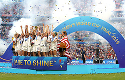 USA's Megan Rapinoe (centre) and team-mates celebrate with the FIFA Women's World Cup Trophy after the final whistle after the FIFA Women's World Cup 2019 Final at the Stade de Lyon, Lyon, France.