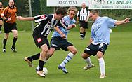 FODBOLD: Christian Pind og Sebastian Hviid (Helsingør) forsøger at stoppe en B.1903-spiller under kampen i Kvalifikationsrækken, pulje 1, mellem B.1903 og Elite 3000 Helsingør den 27. maj 2006 på B.1903's anlæg. Foto: Claus Birch