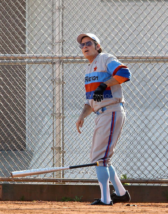November 7th 2011  Los Angeles, CA. <br /> Non Exclusive. <br /> Charlie Sheen is &quot;winning&quot; as he gets his acting career back on track filming scenes for his new movie called A Glimpse Inside the Mind of Charles Swan III. In what could also be good preparation for Charlies possible upcoming Major League 3 film sequel, he spent the day filming baseball scenes. Sheen also filmed a humorous scene in which he flirts with sexy actresses Katheryn Winnick &amp; Mary Elizabeth Winstead at an ice cream truck. Charlie was surrounded on set by his friends. Charlie's best friend, Tony Todd was cast as one of the baseball players and Sheen's long time friend and personal driver picked up Charlie in brand new ultra luxurious and expensive Maybach. <br /> Photo by Eric Ford/On Location News 818-613-3955 info@onlocationnews.com