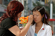 Wangfujing Dajie shopping street and pedestrian zone. Open air cosmetics demonstration.