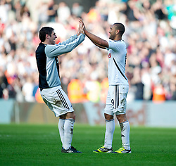 SWANSEA, WALES - Sunday, March 11, 2012: Swansea City's goal scorer Luke Moore celebrates with team-mate Danny Graham after beating Manchester City 1-0 during the Premiership match at the Liberty Stadium. (Pic by David Rawcliffe/Propaganda)