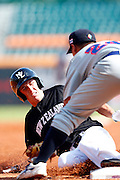 NEW TAIPEI CITY, TAIWAN - NOVEMBER 16:  Max Brown #11 of Team New Zealand slides safely into third base in the top of the third inning during Game 3 of the 2013 World Baseball Classic Qualifier against Team Thailand at Xinzhuang Stadium in New Taipei City, Taiwan on Friday, November 1, 2012.  Photo by Yuki Taguchi/WBCI/MLB Photos
