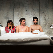 """July 10, 2015 - New York, NY : From left, Alia Attallah, Quinn Franzen, and Karan Oberoi perform in a dress rehearsal for Portland Center Stage<br /> and A Contemporary Theatre (ACT)'s presentation of Yussef El Guindi's """"Threesome"""" at 59E59 on Friday evening. CREDIT: Karsten Moran for The New York Times"""