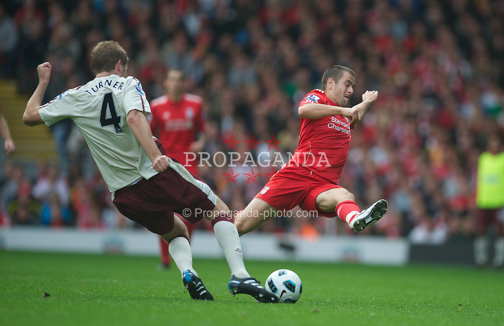 LIVERPOOL, ENGLAND - Saturday, September 25, 2010: Liverpool's Joe Cole and Sunderland's Michael Turner during the Premiership match at Anfield. (Photo by David Rawcliffe/Propaganda)