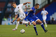 Peter Clarke of Oldham Athletic and Sam Hoskins of Northampton Town battle for the ball during the EFL Sky Bet League 1 match between Oldham Athletic and Northampton Town at Boundary Park, Oldham, England on 16 August 2016. Photo by Simon Brady.