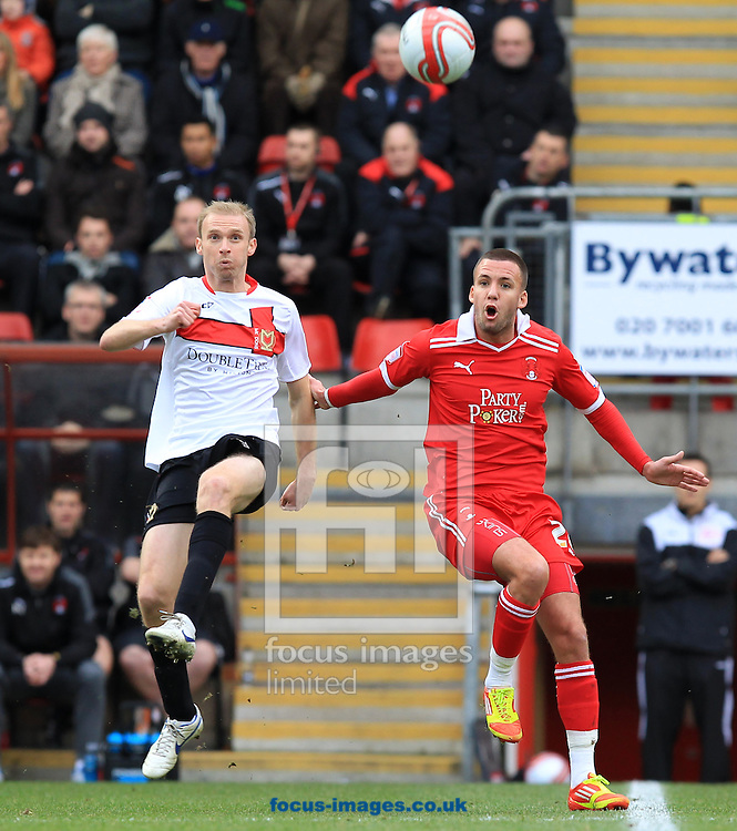 Picture by John Rainford/Focus Images Ltd. 07506 538356.26/12/11.Jimmy Smith of Leyton Orient and Luke Chadwick of MK Dons during the Npower League 1 match at Matchroom stadium, London.