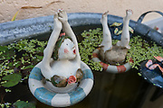 Funny clay figurines dive in pond. Stein am Rhein, Switzerland, Europe.