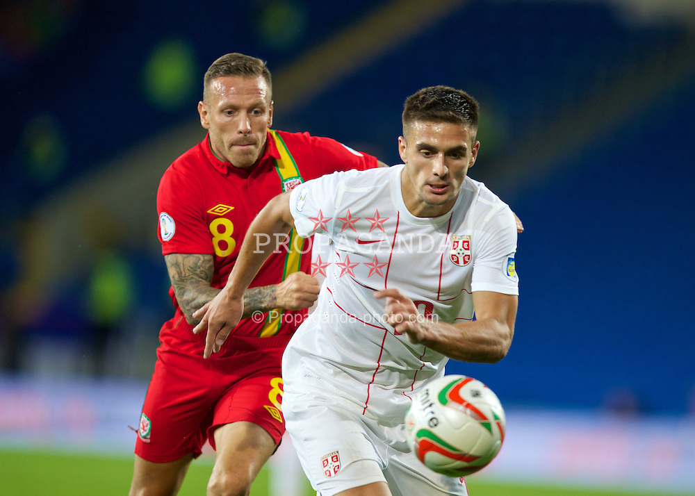 CARDIFF, WALES - Tuesday, September 10, 2013: Wales' Craig Bellamy in action against Serbia's Dusan Tadic during the 2014 FIFA World Cup Brazil Qualifying Group A match at the Cardiff CIty Stadium. (Pic by David Rawcliffe/Propaganda)