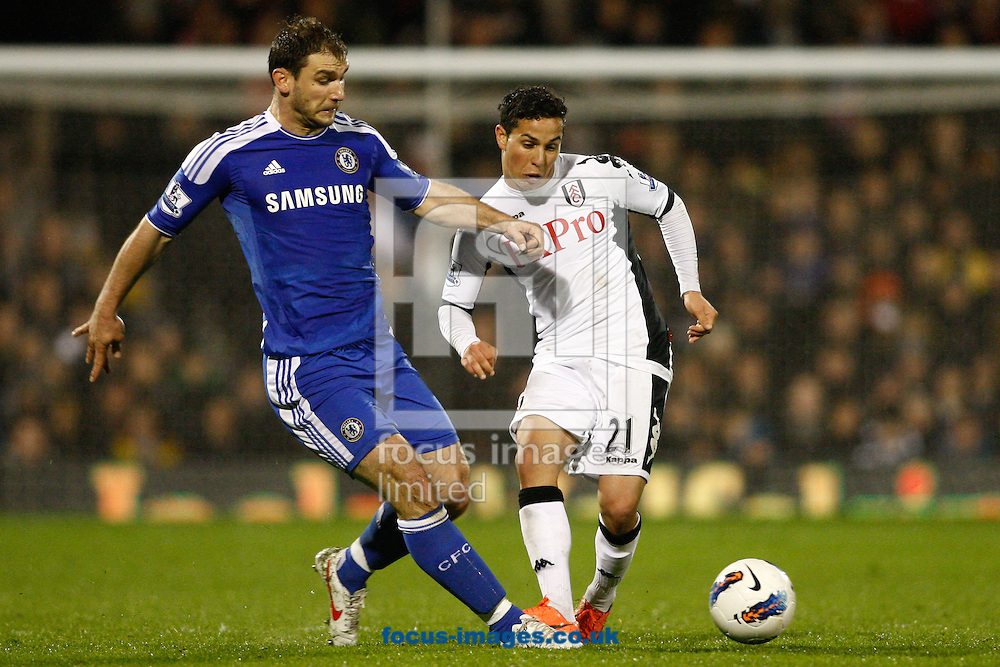 Picture by Andrew Tobin/Focus Images Ltd. 07710 761829. 09/04/12 Kerim Frei of Fulham is challenged by Branislav Ivanovic of Chelsea during the during the Barclays Premier League match between Fulham and Chelsea at Craven Cottage stadium, London