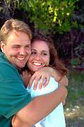 Couple age 25 embracing on summer vacation.  Cedarville  Michigan USA