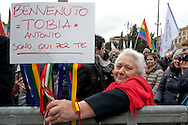 """A supporter of LGBT associations holds a placard reading """" Welcome Tobia Antonio i'm here for you"""" . Tobia Antonio and the son of Nichi Vendola and his companion Eddy Testa.<br /> Rally in central Rome of LGBT associations, for call for more rights for homosexual couples, the protest  after approval of the bill on civil union  which was approved recently by  the Italian Senate. Rome, Italy 5th March 2016"""