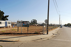 An empty lot along Fremont Street still signposted as under development in the Hebbron ASP policing area. Officers Lofton and Lopez know virtually all the families in this neighborhood.