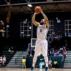Feb 24, 2016; New Orleans, LA, USA; Tulane Green Wave guard Louis Dabney (0) shoots over East Carolina Pirates guard Caleb White (2) during the second half of a game at the Devlin Fieldhouse. Mandatory Credit: Derick E. Hingle-USA TODAY Sports