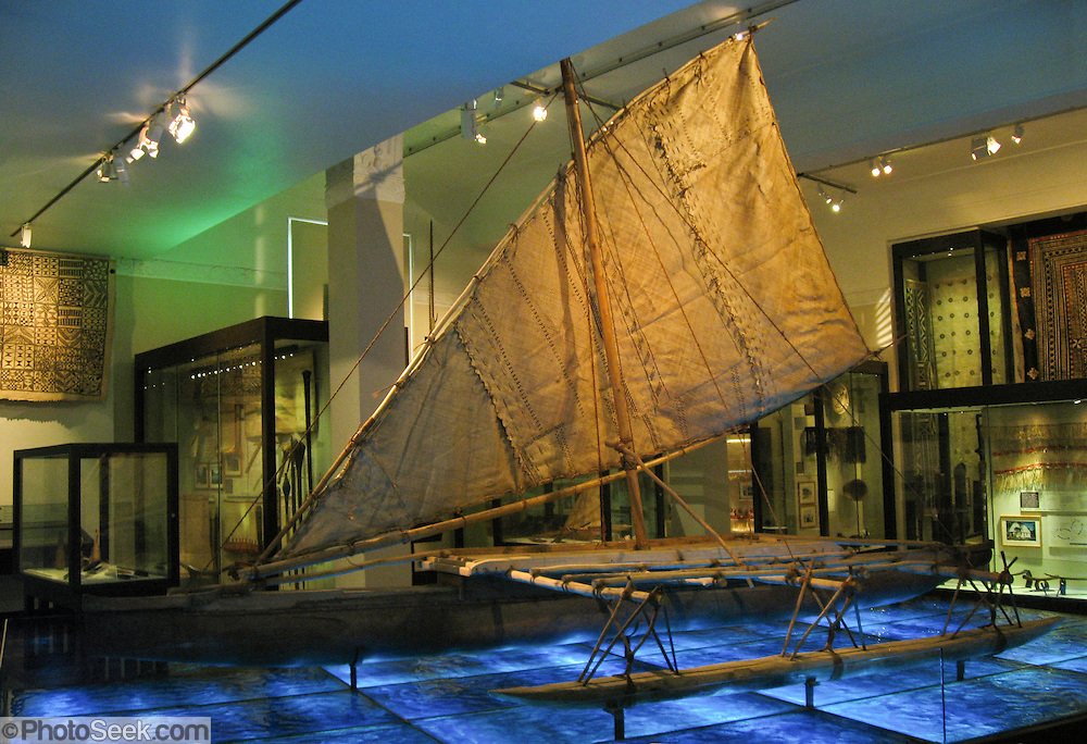 Waka (Polynesian sea canoe) in the Auckland Museum, North Island, New Zealand. The Polynesian navigator Kupe has been credited with the discovery of New Zealand around AD 800. Continuous settlement of New Zealand dates from about 1200 AD, following which a fairly steady migration of people came from Kupe's homeland of Hawaiki (Ra'iatea in modern-day French Polynesia).  Panorama stitched from 2 overlapping images.