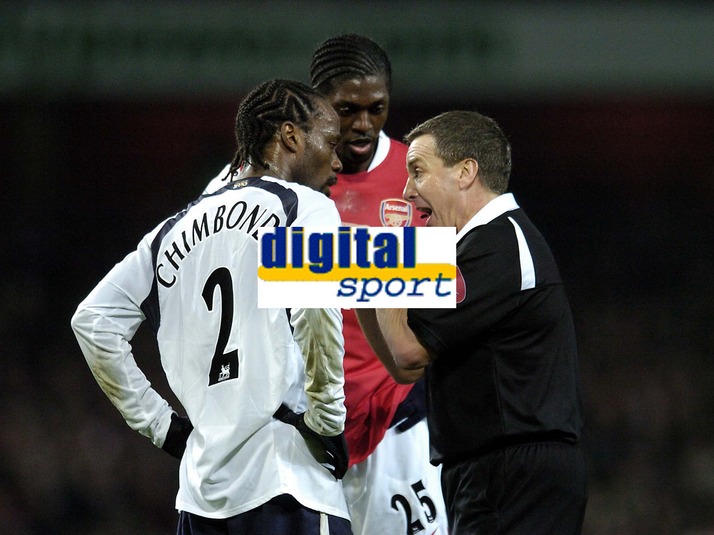 Photo: Olly Greenwood.<br />Arsenal v Tottenham Hotspur. Carling Cup Semi Final 2nd leg 31/01/2007. Spurs Pascal Chimbonda and Arsenal's Emmanuel Adebayor have words with referee Alan Wiley