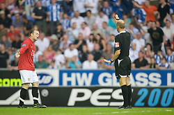 WIGAN, ENGLAND - Sunday, May 11, 2008: Manchester United's Wayne Rooney screams at referee Steve Bennett, but no yellow card was shown, proving how inconsistent the referee is, during the final Premiership match of the season at the JJB Stadium. (Photo by David Rawcliffe/Propaganda)
