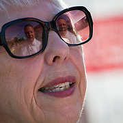 Prince William County Supervisor, Corey Stewart is reflected in the sunglasses of Kay Spyridakis, during an appearance at the Page County , VA GOP Jamboree, in Luray, VA on Saturday, June 25, 2016.  Stewart ran the Trump operation in Virginia and is running for Governor in 2017.  Stewart mingled with guests and made a brief speech, along with other candidates for political office in Virginia.  John Boal Photography