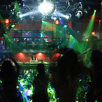 People dancing on a dance floor at a night club