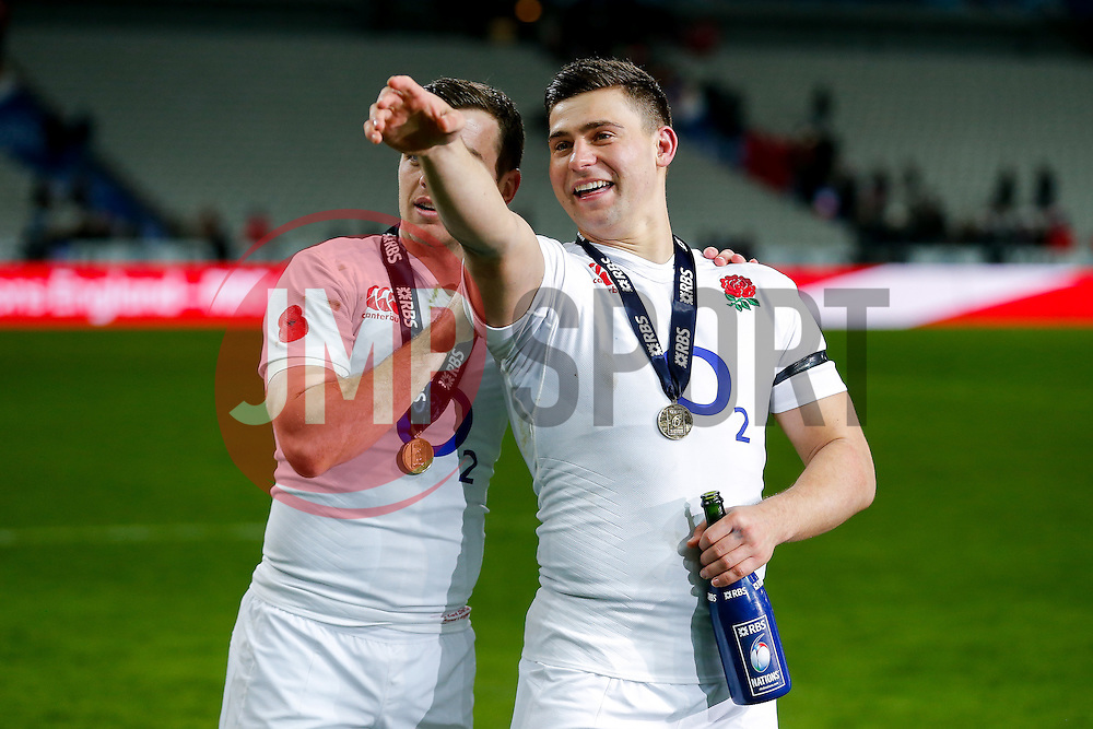 England Scrum-Half Danny Care and Fly-Half George Ford celebrate after their side win the match, the Six Nations title and the Grand Slam - Mandatory byline: Rogan Thomson/JMP - 19/03/2016 - RUGBY UNION - Stade de France - Paris, France - France v England - RBS 6 Nations 2016.