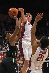 Colorado's George King, left, is defended by Stanford's Michael Humphrey and Cameron Walker (21) during the first half of an NCAA college basketball game in Stanford, Calif., Sunday, Jan. 3, 2016. (AP Photo/Jason O. Watson)