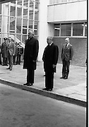 Australian Prime Minister Visits Ireland.   (H79)..1974..23.12.1974..12.23.1974..23rd December 1974..As part of his tour of E.E.C. Capital Cities,Mr Gough Whitlam, the Australian Prime Minister visited Dublin today. In Dublin he will have talks with An Taoiseach, Mr Liam Cosgrave...An Taoiseach,Mr Liam Cosgrave and the Australian prime Minister,Mr Gough Whitlam pictured as they leave the airport on their was to government buildings.