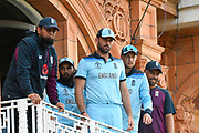 Liam Plunkett of England, Adil Rashid of England and Joe Root of England look down from the England balcony during the ICC Cricket World Cup 2019 Final match between New Zealand and England at Lord's Cricket Ground, St John's Wood, United Kingdom on 14 July 2019.