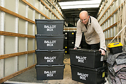 © Licensed to London News Pictures. 06/05/2015. Sheldon, Birmingham, UK. Election ballot boxes being delivered to Sheldon Community Centre, near Birmingham. The ballot boxes have been in archival storage since the last election, they are now delivered to designated distribution centres, from where they will be collected by polling stations in the area in readiness for when the polling stations open. Hundreds of ballot boxes will be in use in Birmingham during the election count. At the close of the election count they will once again be put back into storage. Pictured, Ian Hopkins unloads the boxes. Photo credit : Dave Warren/LNP