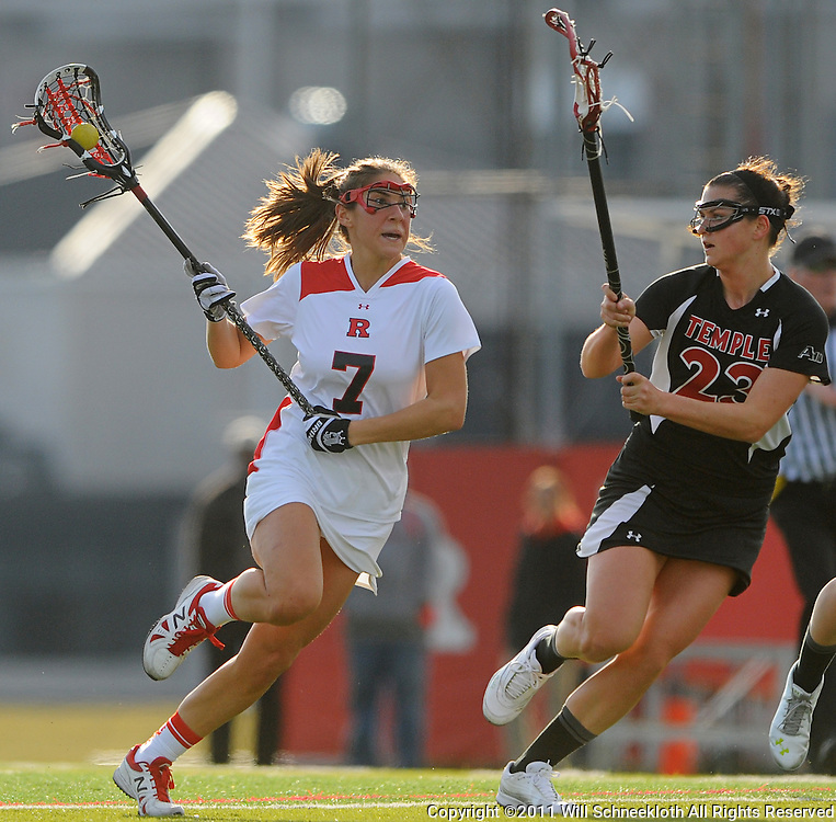 Rutgers senior midfielder Ali Steinberg (7) rushes Temple senior midfielder Kelsey Zenuk (23). Temple defeated Rutgers 12-11 in NCAA women's college lacrosse at the Rutgers Turf Field in Piscataway, N.J.
