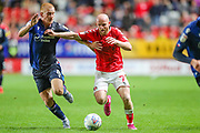 Nottingham Forest midfielder Ben Watson (8) and Charlton Athletic midfielder Jonathan Williams (7) during the EFL Sky Bet Championship match between Charlton Athletic and Nottingham Forest at The Valley, London, England on 21 August 2019.