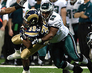 Philadelphia Eagles defensive tackle Mike Patterson (98) wraps up St. Louis Rams running back Steven Jackson (39) after a short run in the first quarter, during the Eagles 17-16 win at the Edward Jones Dome in St. Louis, Missouri, December 18, 2005.