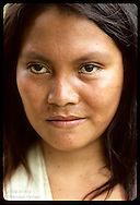Head portrait of young Kanamari Indian woman in tribal village of Tres Unidos, Amazonas Brazil