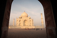 A view of the Taj Mahal through the doorway of an adjacent mosque in Agra, India.
