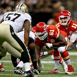 Aug 9, 2013; New Orleans, LA, USA; Kansas City Chiefs quarterback Alex Smith (11) under center center Rodney Hudson (61) against the New Orleans Saints during a preseason game at the Mercedes-Benz Superdome. The Saints defeated the Chiefs 17-13. Mandatory Credit: Derick E. Hingle-USA TODAY Sports