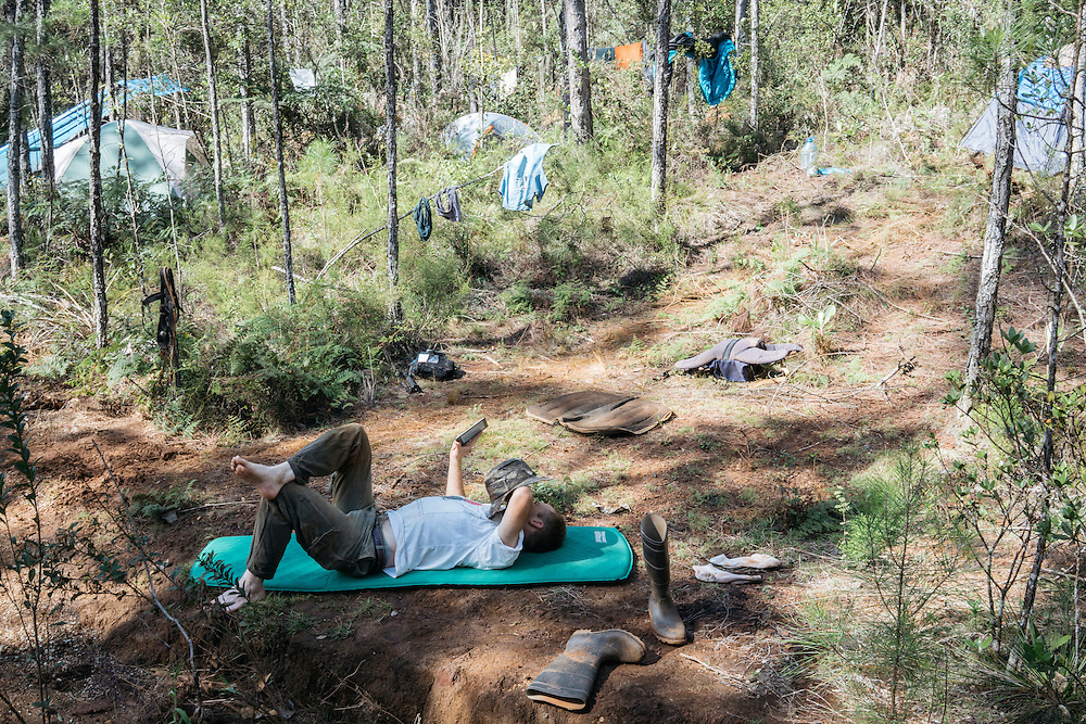 Martjan Lammertink takes a break between morning and afternoon hikes at the Ojito de Agua campsite on Jan. 31, 2016. Searching for the ivory-billed woodpecker was better at dawn and dusk, when the bird was active.