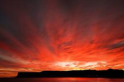 © Licensed to London News Pictures.17/11/15<br /> Saltburn, UK. <br /> <br /> A spectacular sunrise lights up clouds over cliffs on the east coast of England near Saltburn in Cleveland.<br /> <br /> Photo credit : Ian Forsyth/LNP