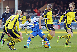 Peterborough United's Erhun Oztumer is disposed by Colchester United's George Moncur - Photo mandatory by-line: Joe Dent/JMP - Mobile: 07966 386802 - 10/01/2015 - SPORT - Football - Peterborough - ABAX Stadium - Peterborough United v Colchester United - Sky Bet League One