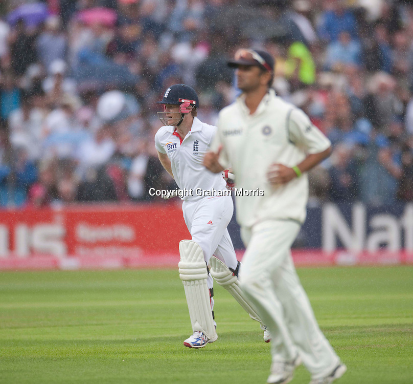 Eoin Morgan (and Rahul Dravid) run off in the rain during the third npower Test Match between England and India at Edgbaston, Birmingham.  Photo: Graham Morris (Tel: +44(0)20 8969 4192 Email: sales@cricketpix.com) 12/08/11