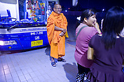 28 FEBRUARY 2008 -- BANGKOK, THAILAND:  A Buddhist monk waits to catch a bus for Bangkok in the bus depot in Mae Sot, Thailand.    PHOTO BY JACK KURTZ